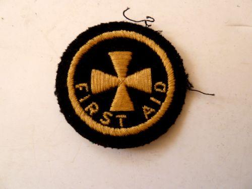 WW2  Civil Defence First Aid Circular Shoulder & Breast Badge