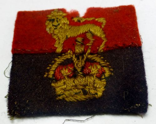 WW2 KC with lion on red & blue backing cloth badge
