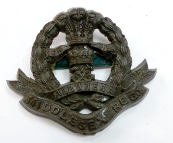 Good Original Middlesex Regt Bakelite Cap Badge