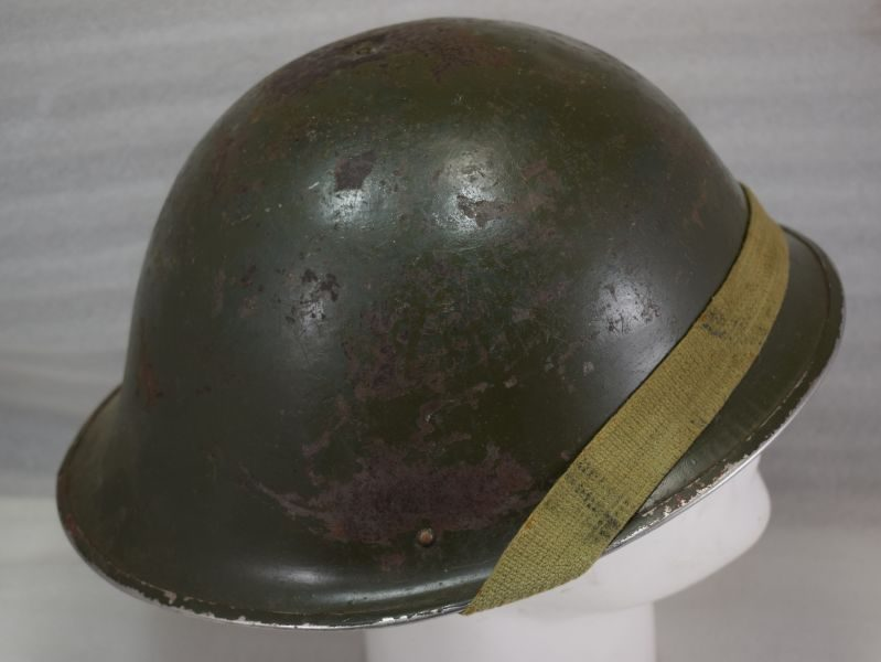 1945 dated shell and liner, the liner is a large size 7 ½ .