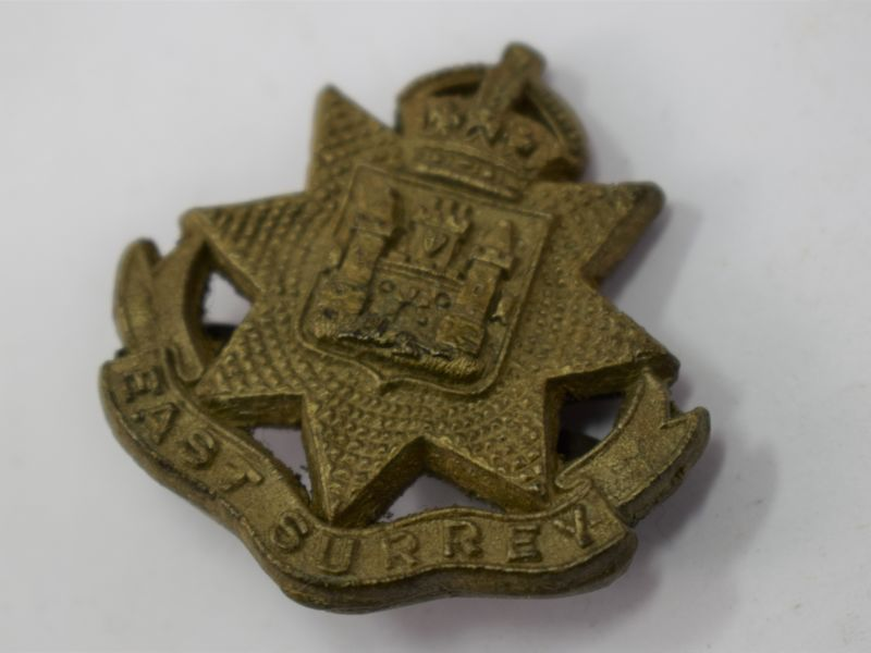 Original WW2 British East Surrey Regt Plastic Economy Cap Badge