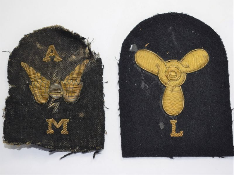 61) A Pair of Vintage Royal Navy Trade Badges with Moth Damage