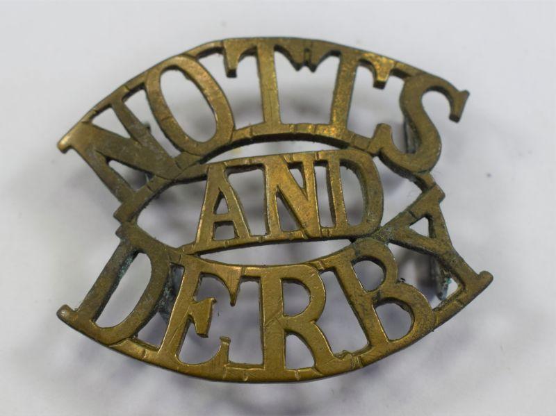 87) Original WW1 Notts And Derby Brass Shoulder Title