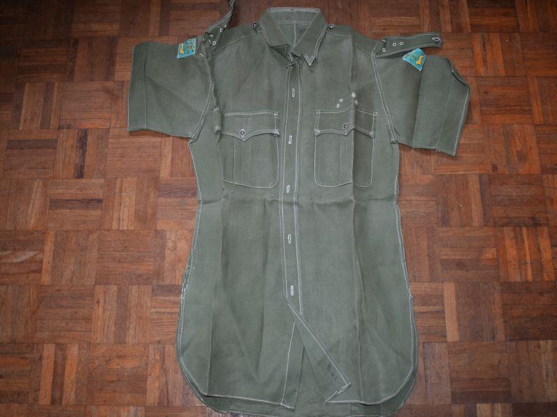 9) Post War JG Aertex Sleeveless Shirt with Singapore District Insignia
