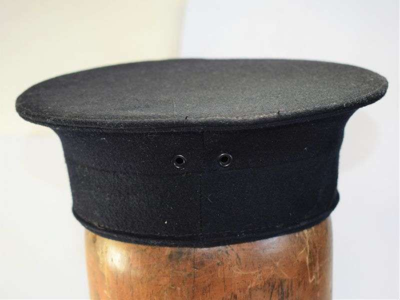 133) Good Unissued WW2 Royal Navy Winter Issue Ratings Cap in Blue.