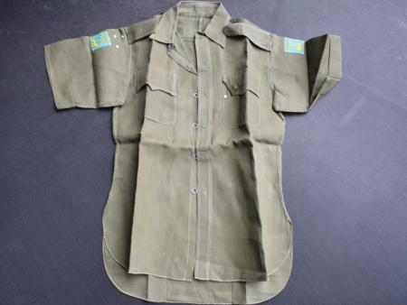 134) Excellent Post War JG Aertex Sleeveless Shirt with Singapore District Insignia